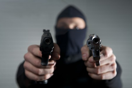 Ganster holding guns in his hands Stock Photo - 4360529