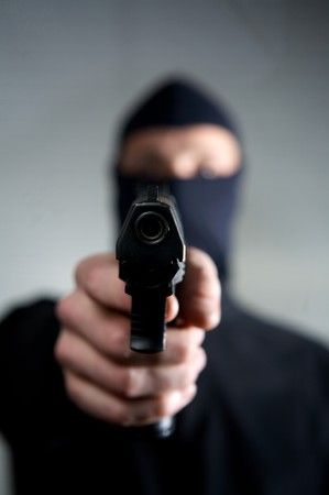 man with a mask a gun ready to use Stock Photo - 4359269