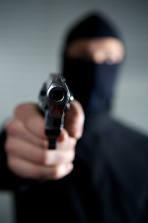 man who want to rob and kill in a property violation Stock Photo - 4359284