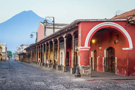 guatemala: View of colonial buildings in Antigua central park with view of Agua volcano in background Stock Photo