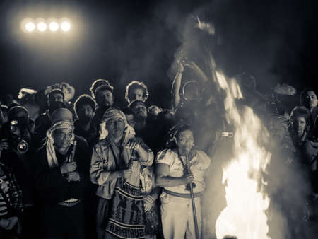 fire surround: Tikal, Guatemala Dec 2012 - People surround a large fire at the Mayan new year celebrations Editorial