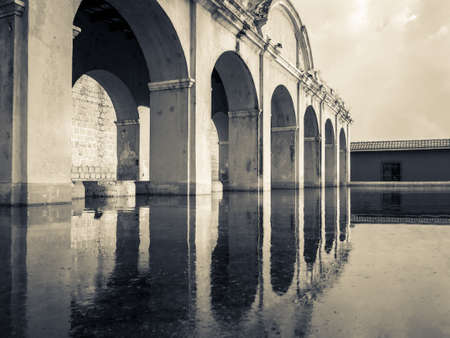 antigua: Arched structure spans waterway   Arches are reflected in water  Stock Photo