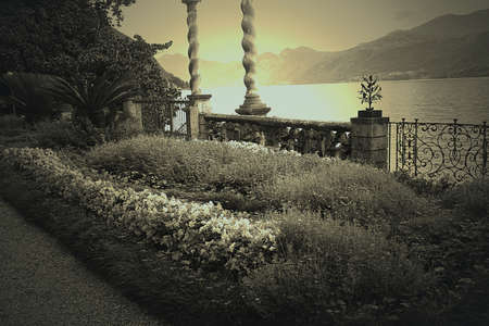 lakeview: Photo in sepia of a terrace with flowers in Varenna, on Lake Como, Italy