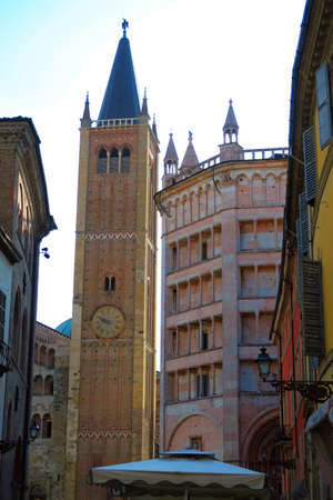 glimpse: Glimpse of a street in Parma, Italy, near the Duomo cathedral squarePiazza. In the background we Recognize the beautiful baptistery thirteenth century, and the XIII century bell tower of the cathedral, 63 meters high