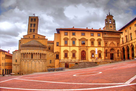 """Arezzo, Italy, 13 march 2016.The Piazza Grande is the most noteworthy medieval square in Arezzo, Tuscany.Once the main marketplace of the city, it is currently the site of the Giostra del Saracino ( """"Joust of the Saracen"""")."""