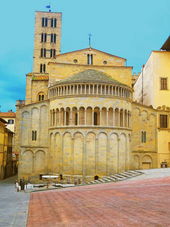 12th century: Arezzo,Italy,13 march 2016.View of the apse of the church of Santa Maria della Pieve overlooking Piazza Grande, in the historic center of Arezzo. It is a 12th century church built in the Romanesque style. Editorial