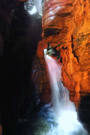obscurity: View of a waterfall in a cave near Lake Garda in Trentino, Italy