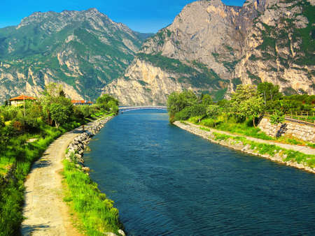 tributary: View of Sarca river as it flows into Lake Garda, Trentino, Italy. This river is the main tributary of the lake.