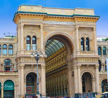 vittorio emanuele: Milan, Italy, 19 june 2016.Entrance gallery Vittorio Emanuele II seen from the Piazza Duomo in Milan, Italy. The Vittorio Emanuele II Gallery in Milan is a shopping arcade, in the form of covered pedestrian street connects Piazza Duomo to Piazza della Sca