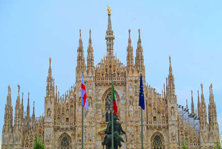 vittorio emanuele: Milan,Italy,19 june 2016.View of a part of the Milan Cathedral and the Vittorio Emanuele statue.Duomo di Milano is the cathedral of Milan,Italy. Dedicated to St Mary of the Nativity,the Gothic cathedral took nearly six centuries to complete. It is the sec