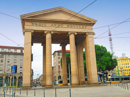 ticinese: Milan, Italy, 19 june 2016.Porta Ticinese is a former city gate of Milan, Italy. The gate, facing south-west, was first created in the 16th century, but the original structure was later demolished, the new structure was designed by Luigi Cagnola in neocla Editorial