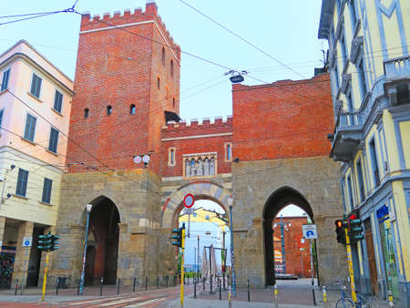 ticinese: Milan,Italy,19 june 2016.The ancient Porta Ticinese is one of the two medieval gates of the city that still exist in the modern Milan. Originally built in the twelfth century, the structure was restored in 1861 by Camillo Boito that inserted two lateral a