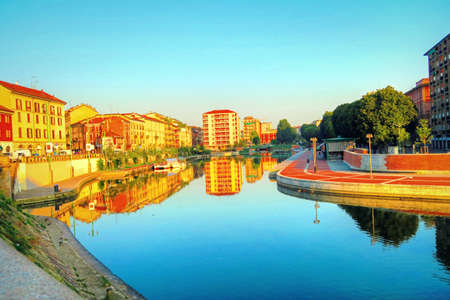 ticinese: The Naviglio Grande is a canal in Milan,Italy, joining the Ticino river to the Porta Ticinese dock, also known as the Darsena, in Milan. It varies in width from 22 m to 50 m.Work of engineering among the most important in the Middle Ages it was completed  Stock Photo