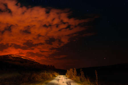nightview of mountain under red clouds