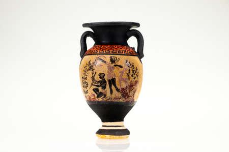A decorative greek vase on a white background