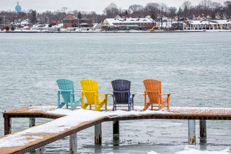 chair waiting to be occupied by the summer crowd Stock Photo