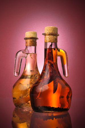 Italian Salad Dressing Oils w/ Chili Peppers and Garlic on a red gradient with rich color and plenty room for ad copy text. Stock Photo - 3641195