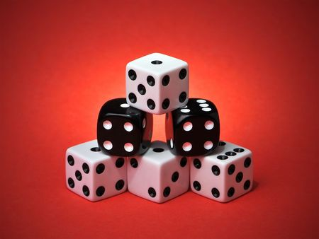 Pyramid Stacked Playing Dice on Red Gradient Background Stock Photo