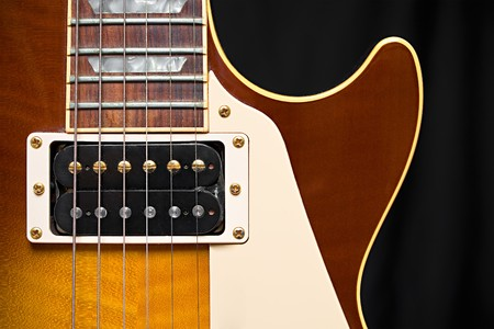 Electric Guitar with Tobacco Honey Sunburst Finish, pickup, frets, and pick guard with room for text