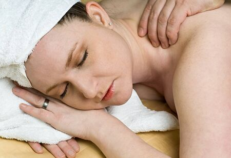 Beautiful Salon Woman Getting Relaxing Massage Therapy at Day Spa