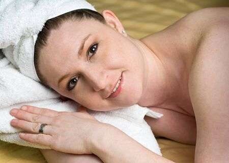 Beautiful Salon Woman Relaxing at Spa with white towel wrapped head