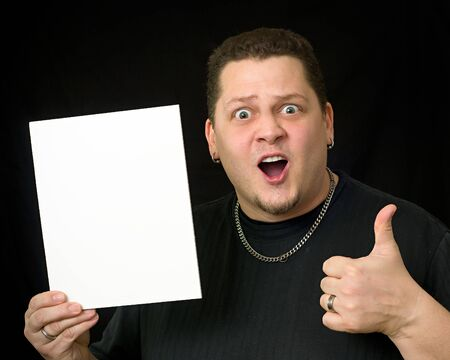 Guy Holding Blank Sign or Paper on solid black background with thumbs up
