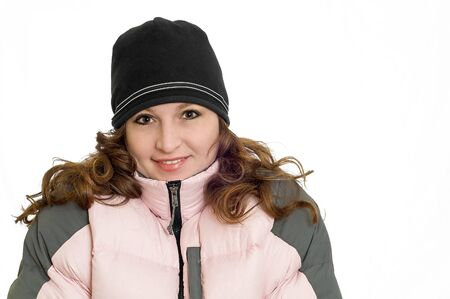 Pretty Redhead Woman Wearing Pink Winter Down Ski Coat and black hat isolated on solid white background Banque d'images