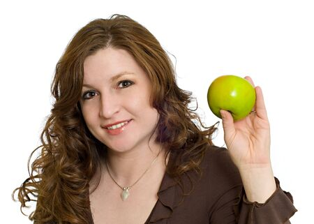 Pretty Woman Smiling and Holding a Fresh Green Apple symbolizing healthy eating and living