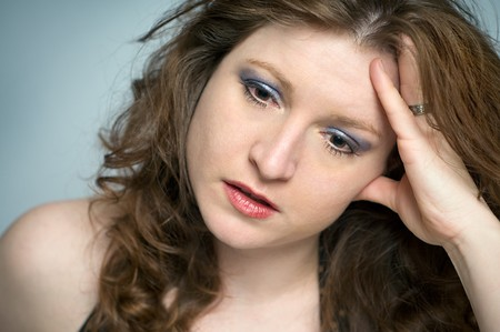 Stressed Woman Portrait looking Upset and Depressed, emotional, disappointed, hurt, or hopeless on blue background Stock Photo - 4164548