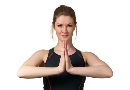 Attracting Young Woman Exercising with Yoga techniques to practice fitness and wellbeing on white background Stock Photo