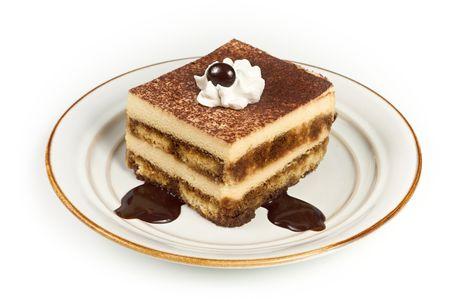 Sweet Italian Layered Tiramisu Cake on Dessert Plate isolated on white background photo