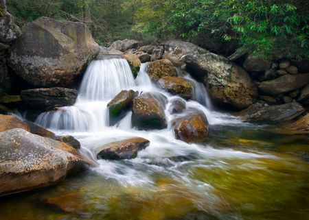 Motion Blur Waterfalls Nature Landscape in Blue Ridge Mountains with green trees, rusty natural orange rocks and flowing water Stock Photo