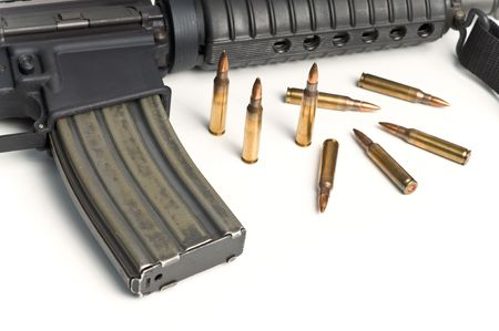 223 Bullets with M16 style Military Assault Rifle on white Stock Photo - 6239743