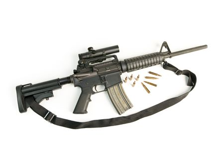 M16 Style Assault Rifle with Scope & Bullets on White Stock Photo - 6239744