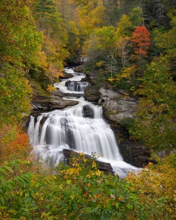 Cullasaja Falls Blue Ridge Mountains waterfalls landscape during autumn fall foliage using slow shutter speed for silky smooth water
