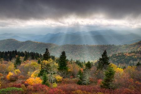 Blue Ridge Parkway Scenic Autumn Landscape with sunbeams over mountains w fall foliage