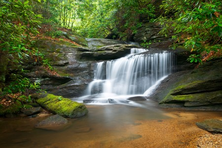 blue ridge mountains: Motion Blur Waterfalls Peaceful Nature Landscape in Blue Ridge Mountains with lush green trees, rocks and flowing water