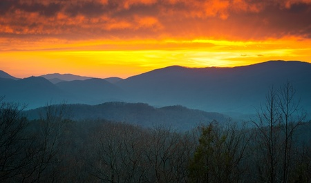 tennessee: Great Smoky Mountains National Park Sunset over Gatlinburg TN with layered mountains Stock Photo