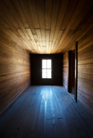 abandoned: Antique Wooden Spooky Abandoned Farm House Neglected Hallway with converging lines to window light source Stock Photo