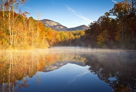 wnc: South Carolina Autumn Sunrise Landscape Table Rock Fall Foliage Reflections fog covered lake