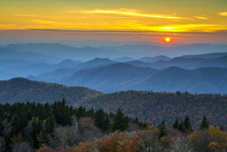 Blue Ridge Parkway Autumn Sunset over Appalachian Mountains Layers covered in fall foliage and blue haze Stock Photo
