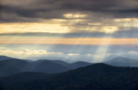 ridge: Crepuscular Light Rays and Sunbeams from Blue Ridge Parkway NC on a spring morning in the Appalachian Mountains near Asheville North Carolina Stock Photo