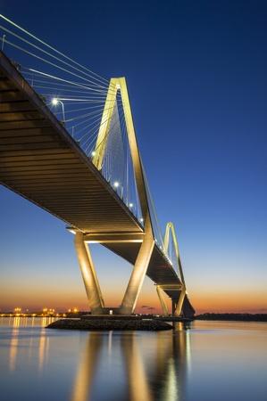 in charleston: Charleston SC Arthur Ravenel Jr  Suspension Bridge over South Carolina Cooper River Sunset on spring evening