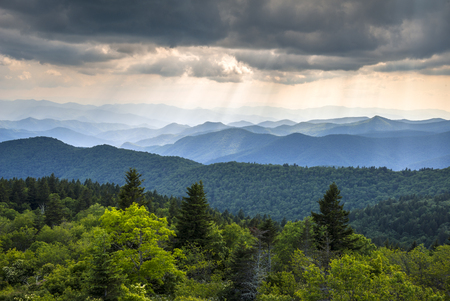 Appalachian Mountains Blue Ridge Parkway Western North Carolina Scenic Landscape photography featuring crepuscular rays of light over endless mountain ridges in summer