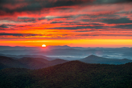nc: North Carolina Blue Ridge Parkway Autumn Sunrise Blue Ridge Mountains in western NC just south of Asheville, NC Stock Photo