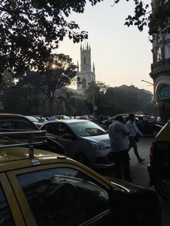 17-Jan-2019-Traffic parked car outside of St. Thomas Cathedral,Horniman Circle, Kala Ghoda, Fort, Mumbai, Maharashtra-INDIA asia