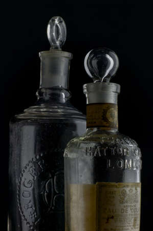 12-sep-2004 vintage european  Eau de Cologne.bottles in black background-Kalyan Maharashtra INDIA Editorial