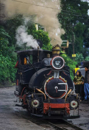 28-Oct-2002-The black steam powered Darjeeling Toy Train approaches in the cityWest Bengal INDIA asia