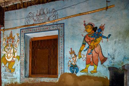 5-Jul-2007-Ganesh Krishna and Balram Mother Jasoda in traditional wall painting outside ruler house Raghurajpur-Orissa INDIA Редакционное