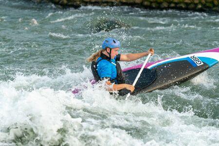 Great Britain Canoe Slalom athlete training on white water
